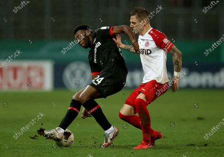 Stock Image of Timothy Fosu-Mensah (L) of Bayer Leverkusen is challenged by Marco Kehl-Gomez of Rot-Weiss Essen during the German DFB Cup Round of Sixteen soccer match between Rot-Weiss Essen and Bayer Leverkusen at Stadion Essen in Essen, Germany, 02 February 2021.