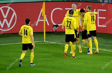 Erling Haaland of Borussia Dortmund celebrates with team mates Julian Brandt  Jadon Sancho and Jude Bellingham after scoring their side's third goal during the DFB Cup Round of Sixteen match between Borussia Dortmund and SC Paderborn 07 in Dortmund, Germany, 02 February 2021.