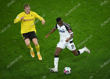 Jamilu Collins of SC Paderborn (R) is put under pressure by Julian Brandt of Borussia Dortmund during the DFB Cup Round of Sixteen match between Borussia Dortmund and SC Paderborn 07 in Dortmund, Germany, 02 February 2021.