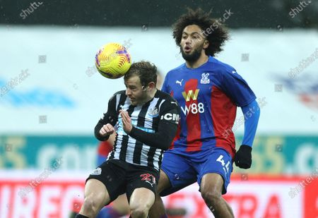 Newcastle's Ryan Fraser, left, and Crystal Palace's Jairo Riedewald challenge for the ball during the English Premier League soccer match between Newcastle United and Crystal Palace at St. James' Park in Newcastle, England