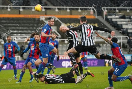 Newcastle's Jonjo Shelvey, centre, heads the ball during the English Premier League soccer match between Newcastle United and Crystal Palace at St. James' Park in Newcastle, England