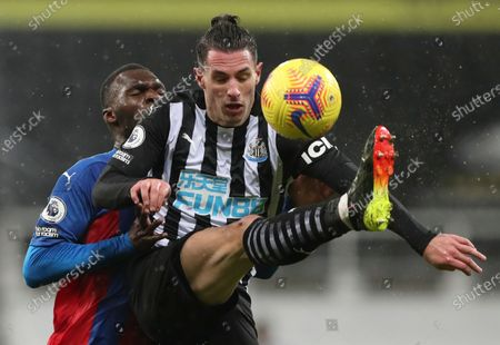 Stock Picture of Newcastle United's Fabian Schar, right, and Crystal Palace's Christian Benteke battle for the ball during the English Premier League soccer match between Newcastle United and Crystal Palace at St. James' Park in Newcastle, England
