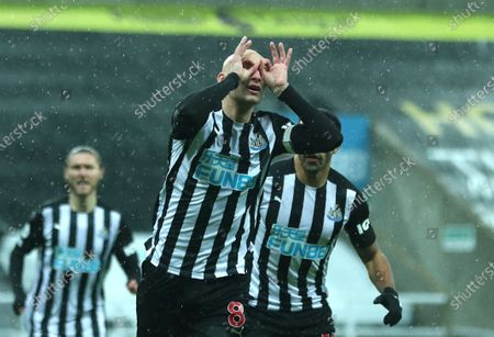 Newcastle's Jonjo Shelvey celebrates after scoring his side's opening goal during the English Premier League soccer match between Newcastle United and Crystal Palace at St. James' Park in Newcastle, England
