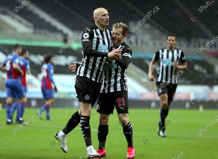 Newcastle's Jonjo Shelvey celebrates with teammate Newcastle's Ryan Fraser after scoring his side's opening goal during the English Premier League soccer match between Newcastle United and Crystal Palace at St. James' Park in Newcastle, England