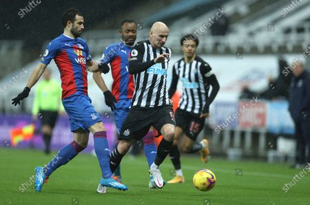 Newcastle's Jonjo Shelvey controls the ball during the English Premier League soccer match between Newcastle United and Crystal Palace at St. James' Park in Newcastle, England
