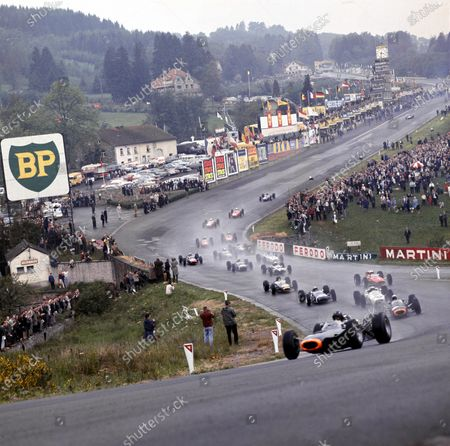 Stock Photo of 1965 Belgian Grand Prix.Spa-Francorchamps, Belgium.11-13 June 1965.Graham Hill leads Jackie Stewart (Both BRM P261's), Richie Ginther (Honda RA272), Jo Siffert (Brabham BT11 BRM), John Surtees (Ferrari 158), Dan Gurney (Brabham BT11 Climax) and the rest of the field through Eau Rouge at the start.Ref-1702.A Race Through Time exhibition number 44.World Copyright - LAT Photographic