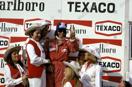 Stock Picture of Emerson Fittipaldi (BRA) McLaren celebrates his victory on the podium.Belgian Grand Prix, Nivelles-Baulers, 12 May 1974.BEST IMAGE