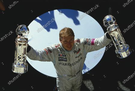 2001 United States Grand Prix.Indianapolis, Indiana, USA.28-30 September 2001.Mika Hakkinen (McLaren Mercedes) celebrates his 1st position on the podium.Ref-01 USA 23.A Race Through Time exhibition number 25.World Copyright - Clive Rose/LAT Photographic