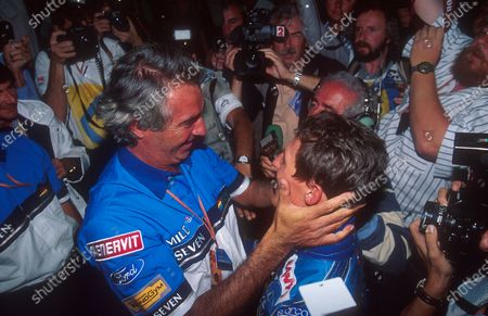 Stock Picture of 1994 Australian Grand Prix.Adelaide, Australia.11-13 November 1994.Benetton team boss Flavio Briatore congratulates his driver Michael Schumacher on becoming the new drivers World Champion.Ref-94 AUS 15.World Copyright - LAT Photographic