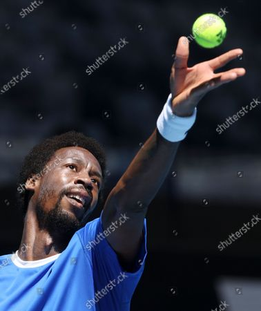 France's Gael Monfils serves to Italy's Matteo Berrettini during their ATP Cup match in Melbourne, Australia
