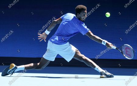 France's Gael Monfils makes a backhand return to Italy's Matteo Berrettini during their ATP Cup match in Melbourne, Australia