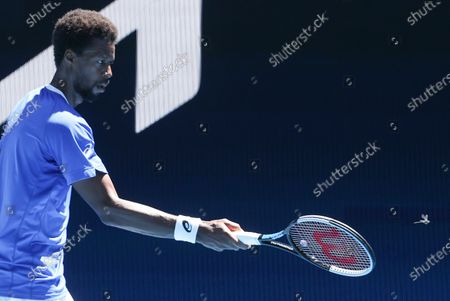 France's Gael Monfils attempts to chase a dragonfly of the court during his match against Italy's Matteo Berrettini at the ATP Cup match in Melbourne, Australia