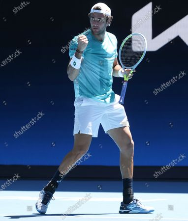 Italy's Matteo Berrettini reacts during his match against France's Gael Monfils at the ATP Cup match in Melbourne, Australia