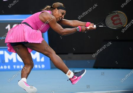 United States' Serena Williams makes a backhand return to Bulgaria's Tsvetana Pironkova during a tuneup event ahead of the Australian Open tennis championships in Melbourne, Australia