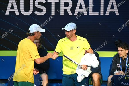 John Millman (C) of Australia is congratulated by Team Australia captain Lleyton Hewitt (L) after defeating Michail Pervolarakis of Greece in their group stage match of the ATP Cup tennis tournament at Melbourne Park in Melbourne, Australia, 03 February 2021.