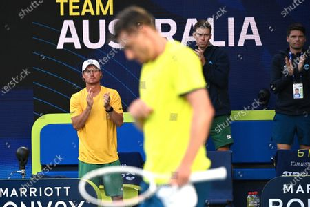 John Millman (front) of Australia is applauded by Team Australia captain Lleyton Hewitt (L) after defeating Michail Pervolarakis of Greece in their group stage match of the ATP Cup tennis tournament at Melbourne Park in Melbourne, Australia, 03 February 2021.