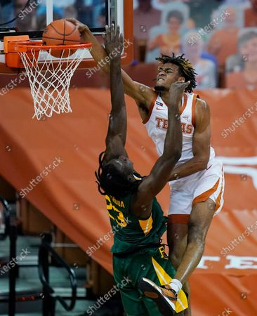 Texas forward Greg Brown, right, scores over Baylor forward Jonathan Tchamwa Tchatchoua (23) during the second half of an NCAA college basketball game, in Austin, Texas