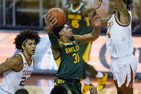Baylor guard MaCio Teague (31) drives to the basket against Texas forward Greg Brown (4) during the second half of an NCAA college basketball game, in Austin, Texas