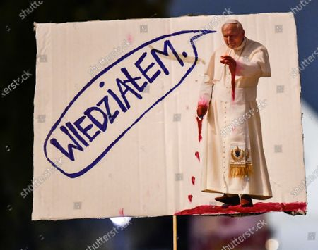 A placard with an image of the Pope John Paul II during the demonstration.