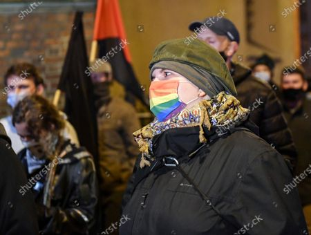 A protester with a LGBTQ mask during the demonstration.