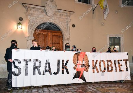 Protesters holding a large banner expressing their opinion during the demonstration.