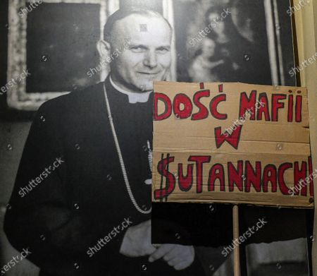 "An image of the Pope John Paul II and the banner saying ""Enough of the mafia in cassocksî during the demonstration.
