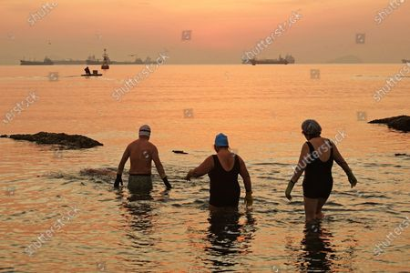 A winter swimming enthusiast swims in Jiazi Bay of Ganjingzi District in Dalian, Liaoning province, Feb 3, 2021. On that day, the first of the 24 solar terms, the Start of Spring, marks the beginning of a new cycle of all living things.