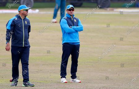 South Africa's head coach Mark Boucher, right, observes players during a practice session at the Pindi Stadium, in Rawalpindi, Pakistan, . Pakistan and South Africa will play second cricket test match in Rawalpindi, starting on Feb. 4