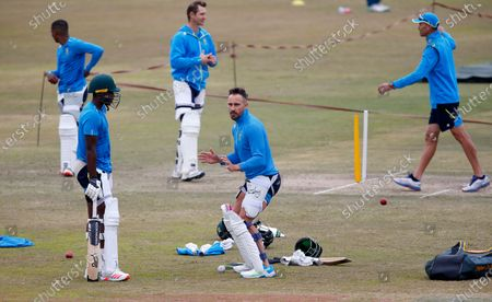 South Africa Faf du Plessis, center, discusses batting tips with teammate Kagiso Rabada, left front, during a practice session at the Pindi Stadium, in Rawalpindi, Pakistan, . Pakistan and South Africa will play second cricket test match in Rawalpindi, starting on Feb. 4