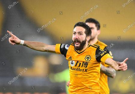 Joao Moutinho of Wolverhampton Wanderers scores and celebrates 2-1