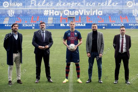 Stock Photo of SD Huesca's new Slovak defender Denis Vavro (C) poses for photographers with Huesca's sports director Ruben Garcia (L) and managing director Manolo Torres (2-L) during his presentation as new player of the Spanish La Liga soccer club at El Alcoraz Stadium in Huesca, north-eastern Spain, 03 February 2021. Vavro joined Huesca on a loan deal from Italian Serie A side SS Lazio until the end of the current season.