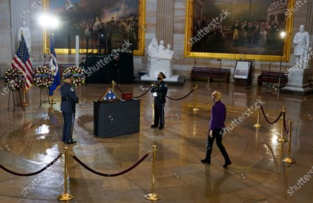 WASHINGTON, DC - FEBRUARY 3: United States Senator Elizabeth Warren (Democrat of Massachusetts) pays her respects before a ceremony memorializing U.S. Capitol Police Officer Brian D. Sicknick, 42, as he lies in honor in the Rotunda of the Capitol. Officer Sicknick was responding to the riot at the U.S. Capitol on Wednesday,, when he was fatally injured while physically engaging with the mob. Members of Congress will pay tribute to the officer on Wednesday morning before his burial at Arlington National Cemetery.