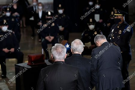 House Minority Leader Kevin McCarthy (R-CA), Senate Minority Leader Senator Mitch McConnell (R-KY), and Senate Majority Leader Charles E. Schumer (D-NY) leave after a ceremony for Capitol Police officer Brian Sicknick in the Rotunda of the US Capitol building in Washington, DC, USA, 03 February 2021. Officer Sicknick was responding to the riot at the U.S. Capitol on 06 January 2021, when he was fatally injured while physically engaging with the mob.