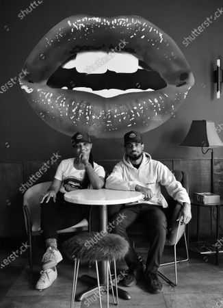 Owners Donna Weekes and Jamane Weekes pose for a photo inside of their business, Lips Cafe, in the East Flatbush neighborhood of Brooklyn, New York City.
