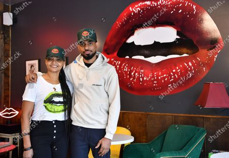 Stock Image of Owners Donna Weekes and Jamane Weekes pose for a photo inside of their business, Lips Cafe, in the East Flatbush neighborhood of Brooklyn, New York City.