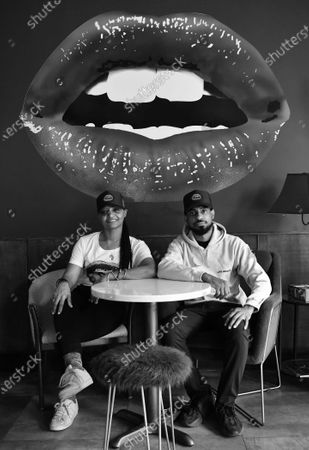 Stock Photo of Owners Donna Weekes and Jamane Weekes pose for a photo inside of their business, Lips Cafe, in the East Flatbush neighborhood of Brooklyn, New York City.