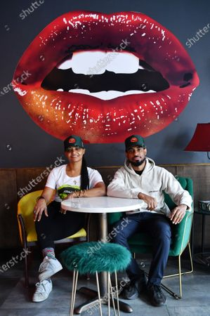 Stock Picture of Owners Donna Weekes and Jamane Weekes pose for a photo inside of their business, Lips Cafe, in the East Flatbush neighborhood of Brooklyn, New York City.