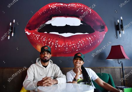 Owners Jamane Weekes and Donna Weekes pose for a photo inside of their business, Lips Cafe, in the East Flatbush neighborhood of Brooklyn, New York City.