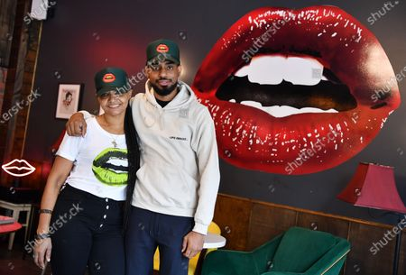 Owners Donna Weekes and Jamane Weekes pose for a photo inside of their business Lips Cafe in the East Flatbush neighborhood of Brooklyn, New York City.