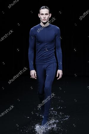 Stock Picture of Model on the catwalk at the Balenciaga Fashion show in Paris, Fall Winter 2020, Ready to Wear Fashion WeekCollection designed by Demna Gvasalia