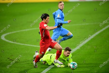 Leipzig's Hee-chan Hwang (L) in action against Bochum's goalkeeper Patrick Drewes (R) during the German DFB Cup round of 16 soccer match between RB Leipzig and VfL Bochum in Leipzig, Germany, 03 February 2021.