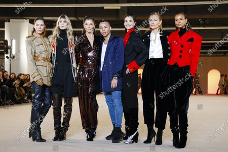 Olivier Rousteing with models on the catwalk at the Balmain Fashion show in Paris, Fall Winter 2020, Ready to Wear Fashion Week