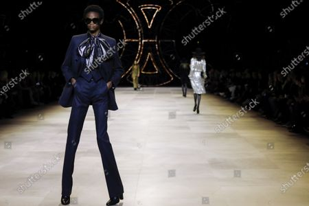 Stock Photo of Model on the catwalk at the Celine Fashion show in Paris, Fall Winter 2020, Ready to Wear Fashion WeekCollection designed by Hedi Slimane