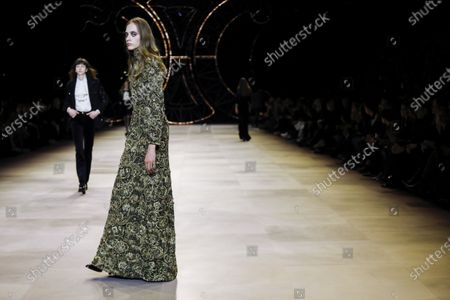 Stock Image of Model on the catwalk at the Celine Fashion show in Paris, Fall Winter 2020, Ready to Wear Fashion WeekCollection designed by Hedi Slimane