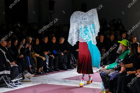 Model on the catwalk at the Comme des Garçons Fashion show in Paris, Fall Winter 2020, Ready to Wear Fashion WeekCollection designed by Rei Kawakubo