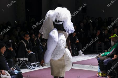 Stock Picture of Model on the catwalk at the Comme des Garçons Fashion show in Paris, Fall Winter 2020, Ready to Wear Fashion WeekCollection designed by Rei Kawakubo