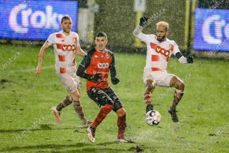 Seraing's Yahya Nadrani and Standard's Mehdi Carcela fight for the ball during a soccer game between RFC Seraing (1B second division) and Standard de Liege (1A first division), Wednesday 03 February 2021 in Liege, in the 1/16 finals of the 'Croky Cup' Belgian cup.