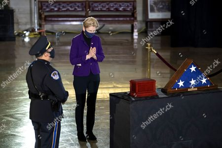 Senator Elizabeth Warren (D-MA) pays her respects to Capitol Police officer Brian Sicknick, who died from injuries sustained during a January 6th insurrection and whose remains were brought to lie in honor in the Capitol Rotunda