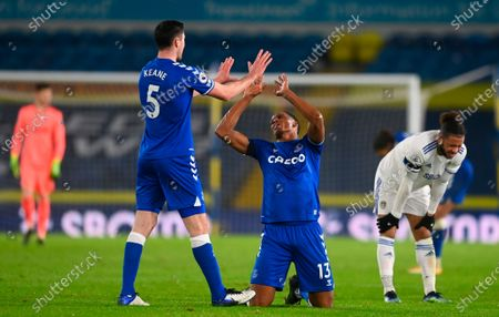 Everton's Michael Keane (center L) and Everton's Yerry Mina (center R) react after the English Premier League soccer match between Leeds United and Everton FC in Leeds, Britain, 03 February 2021.