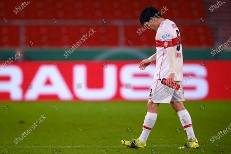 Wataru Endo of VfB Stuttgart looks dejected during the DFB Cup Round of Sixteen match between VfB Stuttgart and Borussia Moenchengladbach at Mercedes-Benz Arena in Stuttgart, Germany, 03 February 2021.